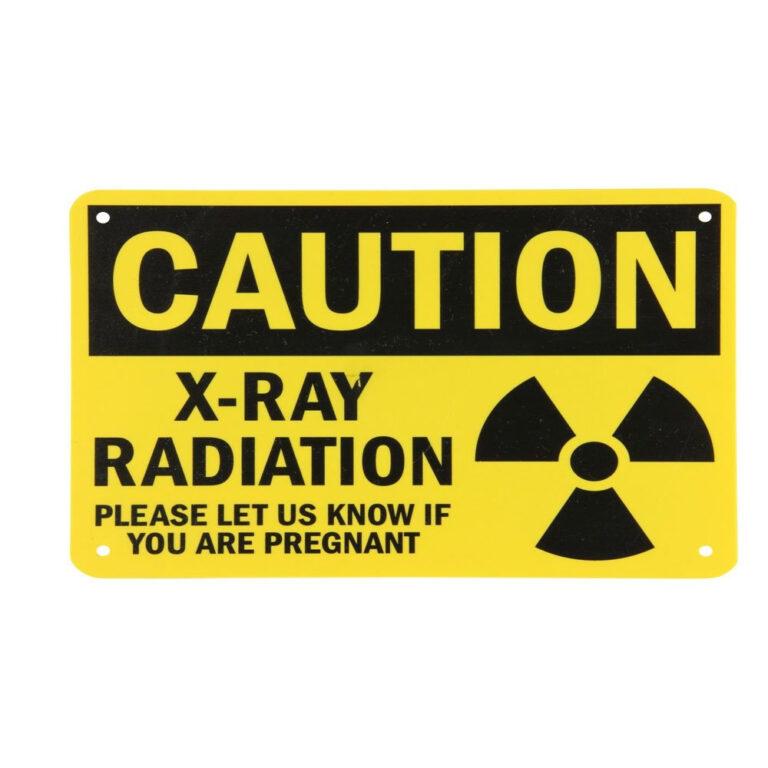 Yellow plastic caution sign caution-x-ray-radiation
